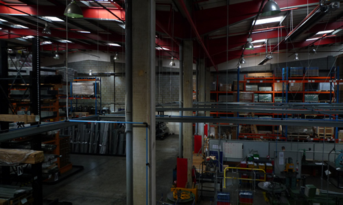 Lighing installation on factory floor in Southwest London